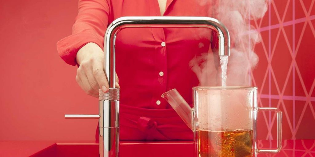 Image of a Quooker boing water tap filling a tea pot