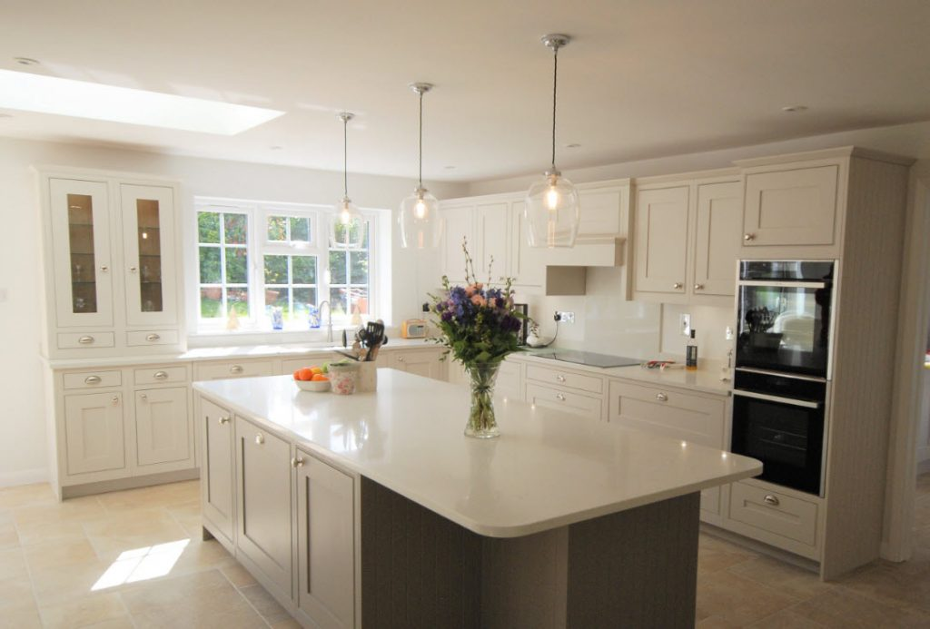 Image of a kitchen in Surrey with beautiful pendant lights over the island