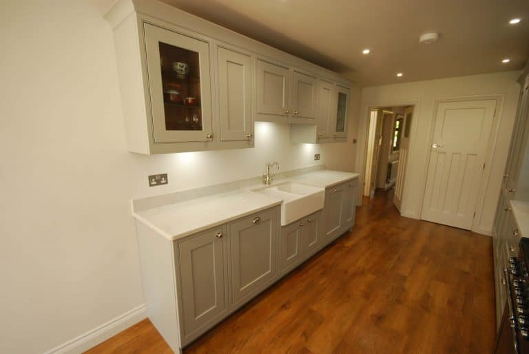 Image of an in-frame painted kitchen with woodgrain.