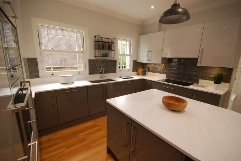 Image of a high gloss grey apartment kitchen