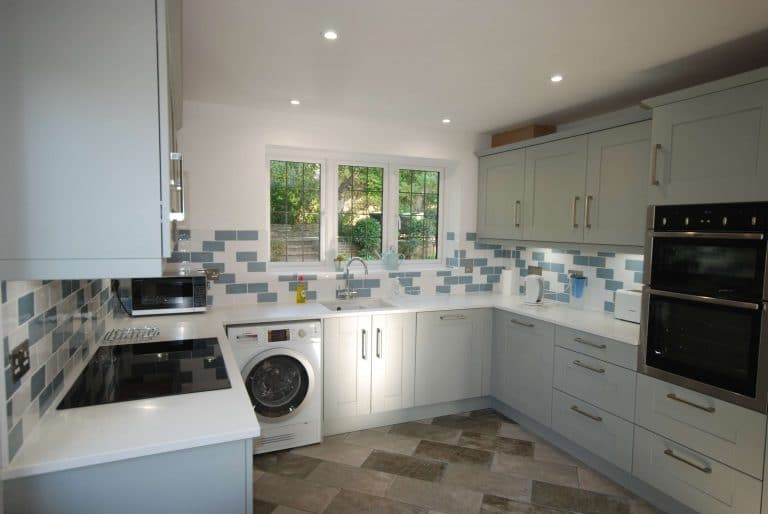 Panoramic photo of a kitchen installation in Godalming